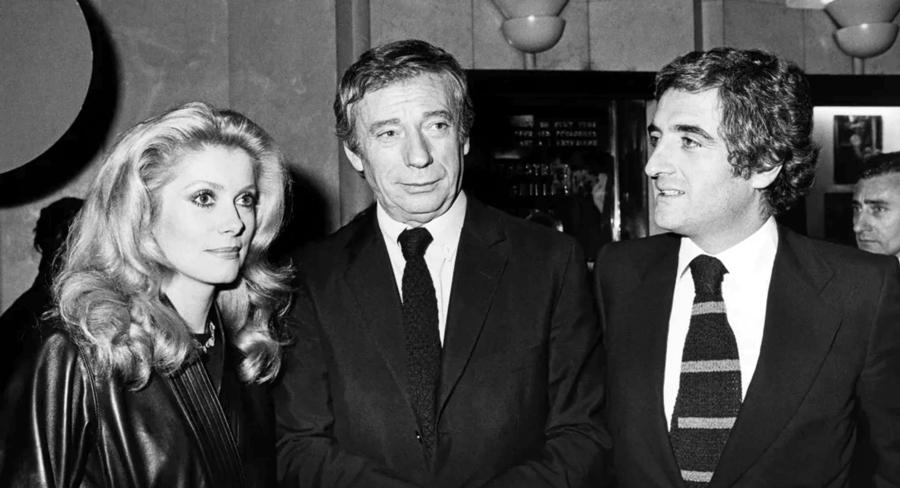 Catherine Deneuve, Yves Montand et Jean-Loup Dabadie à la première du film de Jean-Paul Rappeneau Le Sauvage (1975) - © Patrice Picot